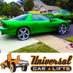 Lifted chevy camaro on 26 iroc rims and tires. Lift kit includes cups, shocks, and front arms.