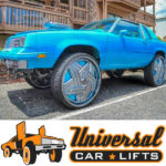 Blue cutlass supreme convertible on 26, 28, or 30 inch Dub baller wheels like in donk magazine box and bubble.