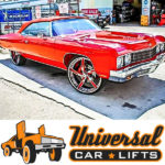 Red Donk Caprice and Impala with big brake upgrade kit lifted on chrome Forgiato rims 3 piece forged.