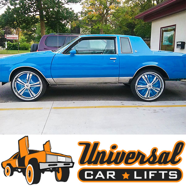Blue Buick Regal on 24s, 26s, or 28s with wheel dust sheilds and custom suspension control arm lift kit. 78, 79, 80, 81, 82, 83 and 84 year range.