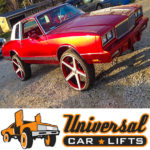 Candy apple red Monte Carlo lifted on 26 Iroc rims and tires. Custom grill, accessories, t tops, and twin turbo motor.
