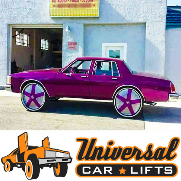 Candy painted 4 door box Chevy Caprice on 32 inch spinner floaters by Dub wheels.