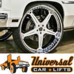 Wilwood brakes with 30 inch Forgiato rims on a white donk chevy caprice.