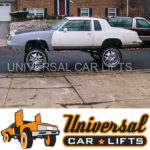 Monster truck car with huge rims donked out by universal lift kits from trusted source. Install is easy.