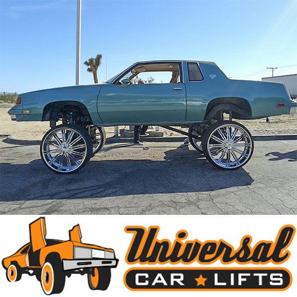 Cutlass on 32's with high riser universal car lifts kit installed with crossmember for frame.