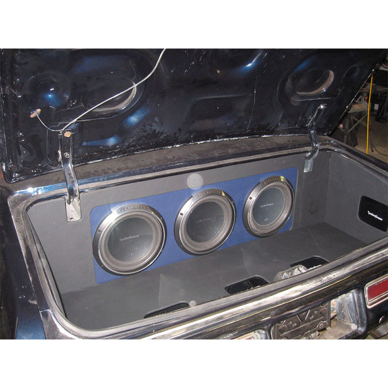 Custom fiberglass speaker box enclosure in donk Chevy Caprice with Rockford Fosgate amps.