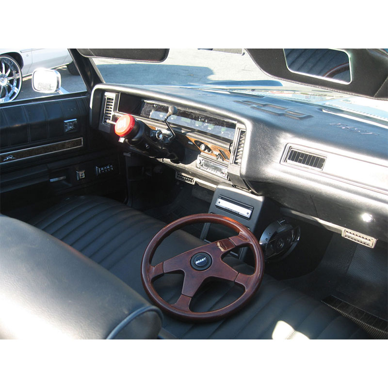 Leather interior redone in this 1972 Chevy donk convertible. Grant steering wheel is installed with hub adapter.
