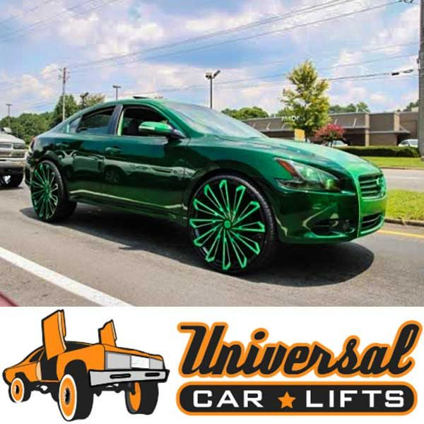 Nissan Maxima on 26's using modified struts lifted from UCL.